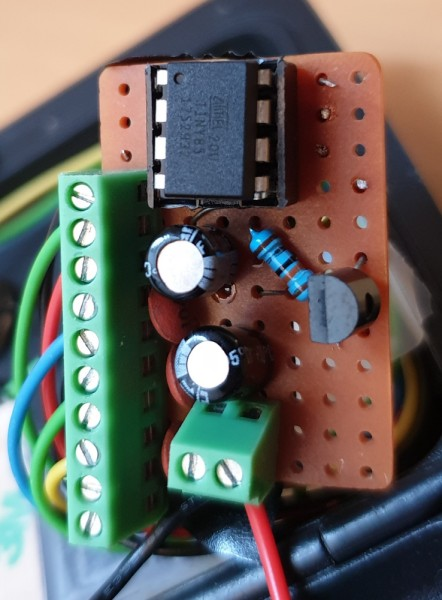A close-up of the final wired-up circuit board, including an unused transistor and resistor.