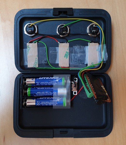 The open toothbrush timer case, showing the buttons, LED strip sections, battery enclosure, perfboard and wiring.